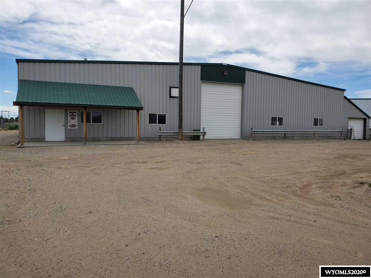 """Great investment opportunity.  100' X 225' dirt floor indoor arena with 16' X 225' (3,600 sf) Lean-To addition & 810 sq. ft. addition with overhead door.  Covered hay storage and 2 loafing sheds on site. Wire fence around entire 3.75 acres in city limits.  Corral Panel at the back of the arena stay. """"As Is, Where Is"""""""