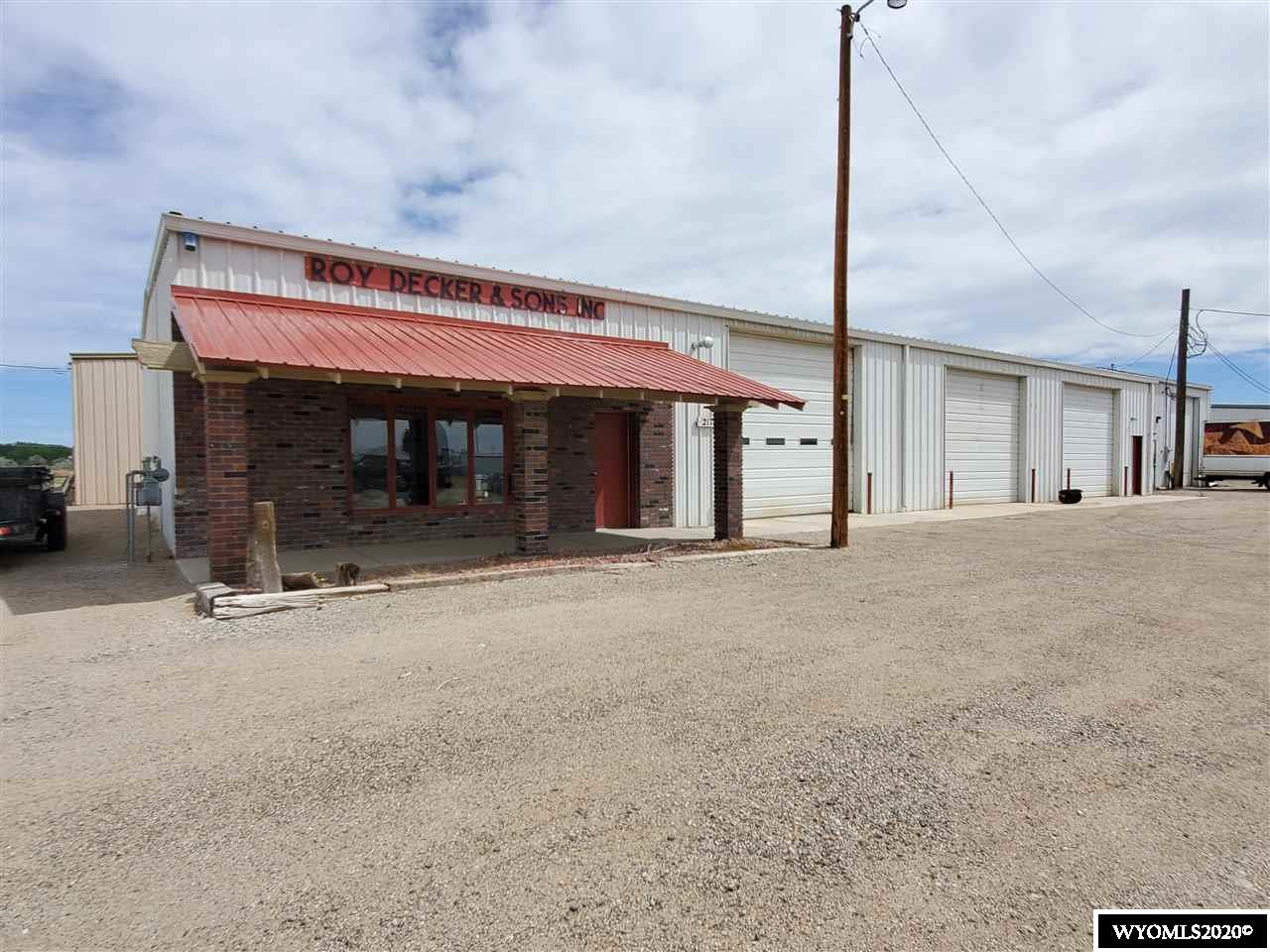 """Great investment opportunity. Commercial lot with three steel buildings in the Industrial Addition of Worland.  Main building features 5,000 sq. ft., a 300 sq. ft. loft 3 large garage bays and office space.  2nd building has 2,400 sq. ft. with a 280 sq. ft. loft, and 1 garage bay. 3rd building has 5,000 sq. ft., and 4 garage bays. Sale includes and and buildings only. Sold """"As Is, Where Is"""""""
