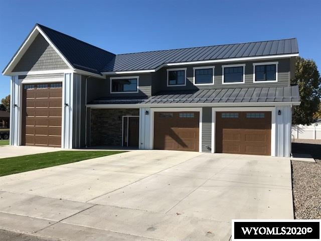 If you are that person or couple looking for adventure and an escape, here is the perfect place to do it in tax friendly Wyoming! This high-end custom home completed in 2019 has everything it takes to become your very own basecamp to adventure. The exterior of this totally custom build is nearly maintenance free and the eco-friendly spray foam insulation used throughout makes it amazingly energy efficient. The lower level includes a huge fully finished, heated, and well lit garage/shop with industrial grade wiring to power any and all of your hobby equipment. There is also a 16' x 54' drive through RV bay for your motorhome or 5th wheel. This fully finished and heated space has metal lined walls and a floor sloping to a sump drain to accommodate the included hot high pressure washer.   Topping off the list of lower level features is a 150 square foot reloading/hobby room, a mechanical room, 1/2 bath, and a beautiful foyer with a vaulted ceiling.  An amazing reclaimed hardwood stairway with custom metal industrial look handrails leads from the foyer to the upper level living with its vaulted ceilings.   The 1600+ square feet of living space is waiting for you to be the first to enjoy its many custom amenities. The entire upper area, other than the tiled bathroom, has a reclaimed custom milled mixed hardwood floor which originated in an early 1900s Wisconsin barn. Rough sawn and sanded reclaimed wood is used throughout the living area as base, window, and door trim. This beautiful material also originated in an early 1900s Wisconsin barn. Large industrial ceiling fans hang in the foyer, great room, and bedroom.   You will enjoy the solid maple kitchen cabinets with beautiful concrete countertops and stainless steel Whirlpool appliances. The large master suite includes a large walk-in closet and bathroom with a double vanity, tile floor, a beautifully tiled glass enclosed oversize shower, and a GE laundry center.   Words and pictures can't begin to show the attention t