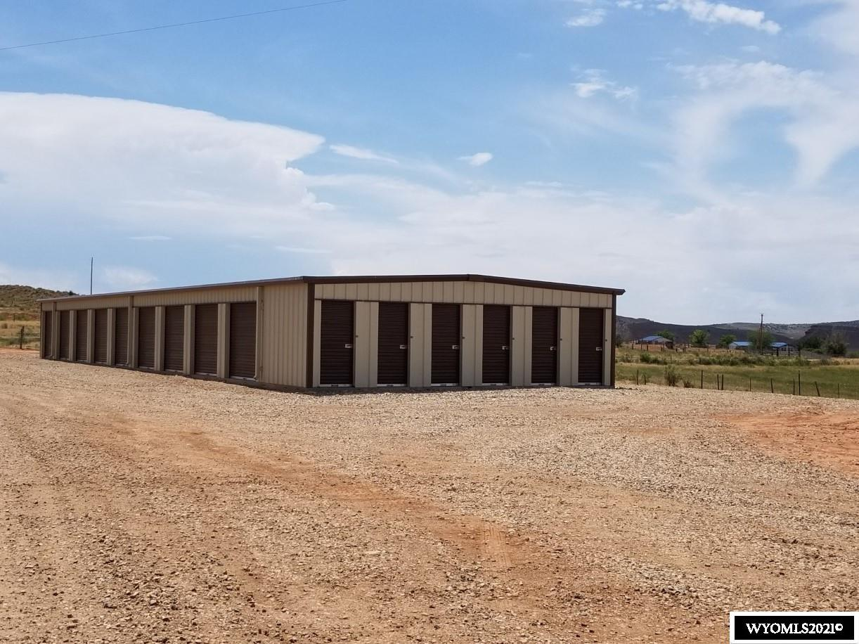 Storage Units! Income producing, low maintenance, no overheard investment opportunity near Ten Sleep.  A total of 24 storage units offered with various sizes.  This property is 2.03 acres and offers a beautiful building site for your new home. Enjoy quiet country living and red dirt views every direction. Modulars and horses allowed. Water rights included. Water tap and power available.