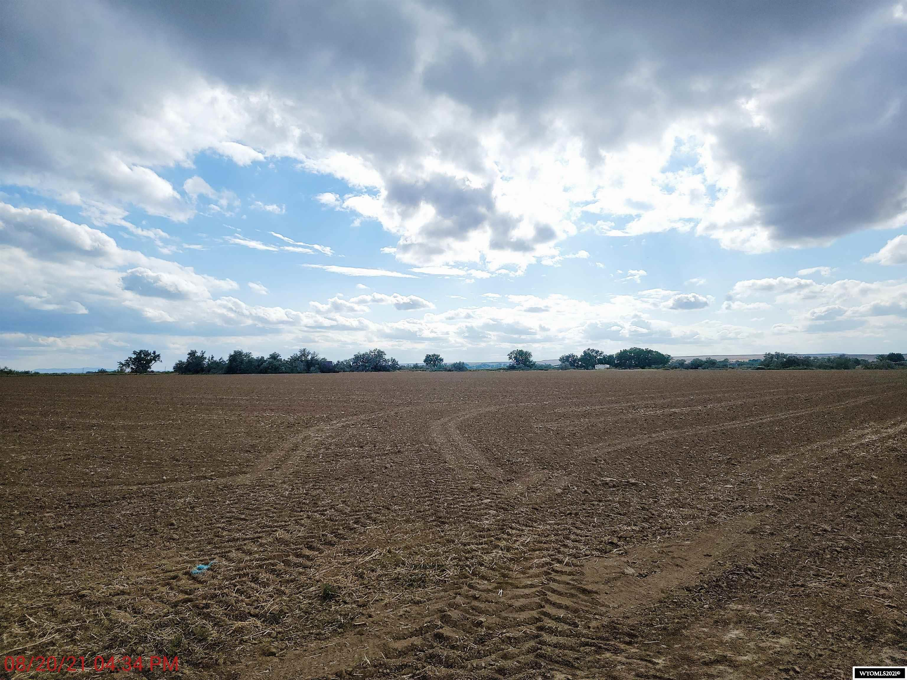 27.71 acres of irrigated farm land.  This land was planted in barley for the 2021 growing season.  Land was leased to neighboring farmer.  Great potential for a building site, gentleman's farm, would make great pasture of horses, cows or sheep. Call McGarvin & Taylor 307-347-4271, this won't last long